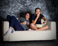 Two young girls looks TV Royalty Free Stock Photography