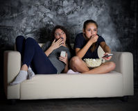 Two young girls looks TV Stock Image