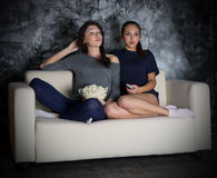 Two young girls looks TV Royalty Free Stock Images