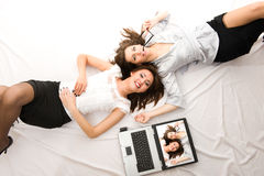 Two Young girls lying on the floor Royalty Free Stock Photos