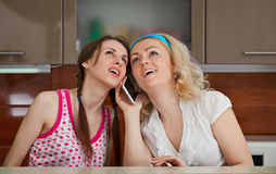 Two young girls make a phone call Stock Photo
