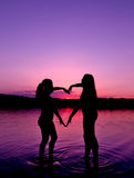 Two Young girls Make The Shape of Heart Royalty Free Stock Photography