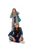 Two young girls making a phone call Royalty Free Stock Image