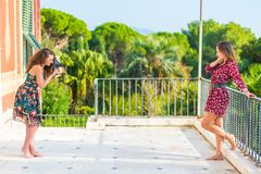 Taking a picture of her girlfriend royalty free stock images