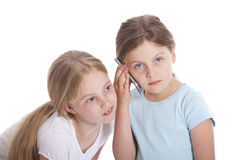 Two young girls with mobile phone Royalty Free Stock Photo