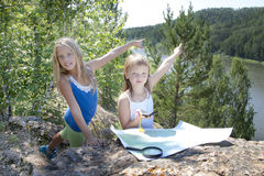 Two Young Girls   in Mountain read the Map near Stock Image