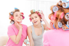 Two young girls near the mirror Stock Images