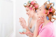 Two young girls near the mirror Stock Photos