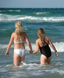 Two young girls and the ocean Stock Image