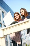 Two young girls outside with laptop Stock Images