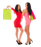 Two young girls with paper bags Royalty Free Stock Images
