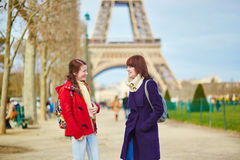 Two young girls in Paris near the Eiffel tower Stock Photo