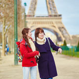 Two young girls in Paris near the Eiffel tower Stock Photos