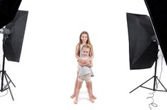 Two young girls in photo studio Royalty Free Stock Images