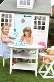 Two young girls play outdoors Royalty Free Stock Image