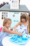 Two young girls play outdoors Royalty Free Stock Photo