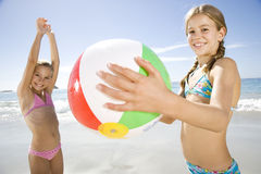 Two young girls playing on the beach Stock Image