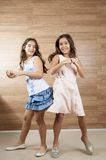 Two young girls playing Royalty Free Stock Photos