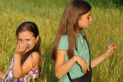 Two young girls playing outdoor Royalty Free Stock Photos
