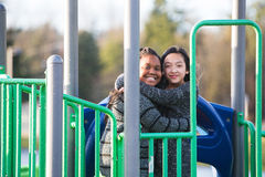 Two young girls playing at recess Stock Images