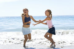 Two young girls playing in the sea Stock Photo
