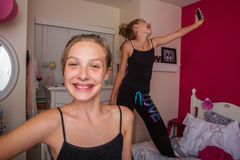 Two young girls playing in their room Stock Images