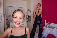 Two young girls playing in their room Stock Image