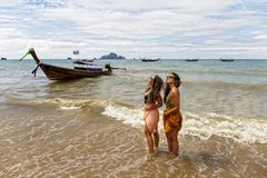 Two young girls pose on the shore of Krabi beach stock photos
