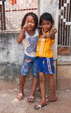 Two young girls posing outside in Siem Reap Cambodia royalty free stock image