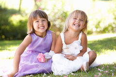 Two young girls posing in park Stock Photo