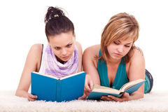 Two young girls  reading books Royalty Free Stock Photo