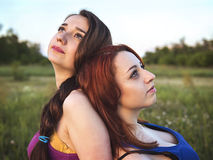 Two young girls on a rest outdoors Stock Photos