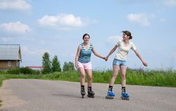Two Young girls on roller blades Stock Photo