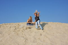Two young  girls on a sand-pit Stock Image