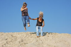Two young  girls on a sand-pit Stock Photography