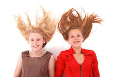 Two young girls with scattered long hairs Stock Photos