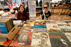 Two young girls sell vintage vinyl records royalty free stock photo