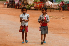 Two Young girls selling handicrafts in Angkor Wat royalty free stock photo