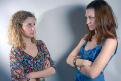 Two young girls seriously crossed Royalty Free Stock Image