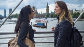 Two young girls on a sightseeing tour through London. Travel photography Stock Photos