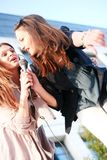 Two young girls singing karaoke Royalty Free Stock Photography