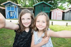 Two young girls sisters children make selfie picture. Outdoor royalty free stock photos