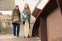 Two young girls with skateboards Royalty Free Stock Images