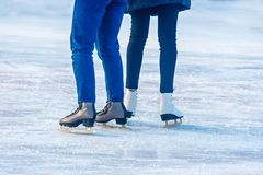 Two young girls are skating on the rink. Feet closeup Royalty Free Stock Image