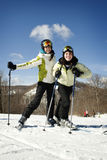 Two young girls skiing together Stock Image