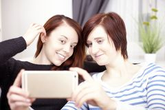 Two young girls with smart phone Royalty Free Stock Photo