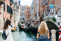 Two young girls stand on the gondola service stock photos
