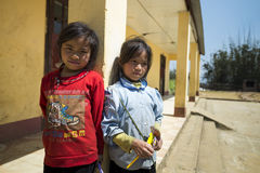 Two young girls standing at rural school compound Royalty Free Stock Photography