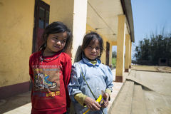 Two young girls standing at rural school compound Stock Photography
