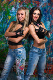 Two young girls stands near wall with graffiti Stock Photography